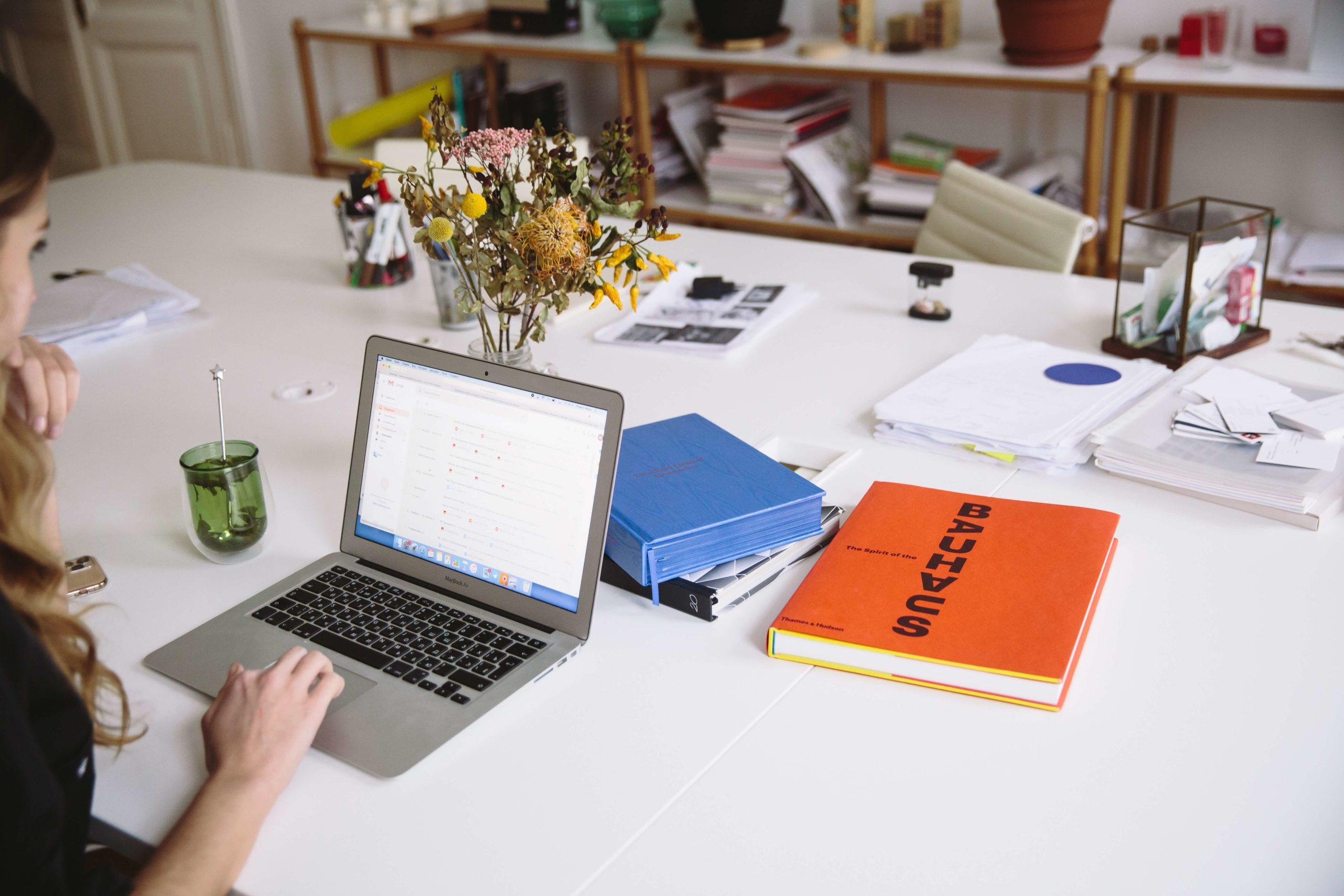 photo of orange book beside laptop 3747455 1 scaled