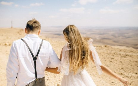 photo of couple holding hands 4693220